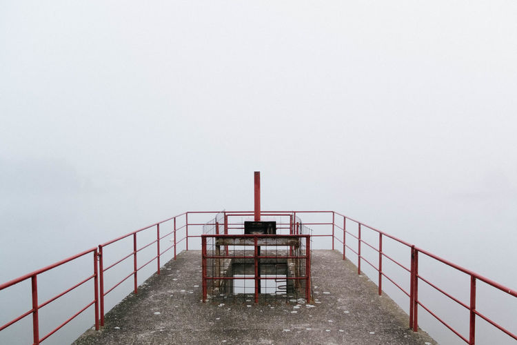 Steps leading towards sea against clear sky during winter