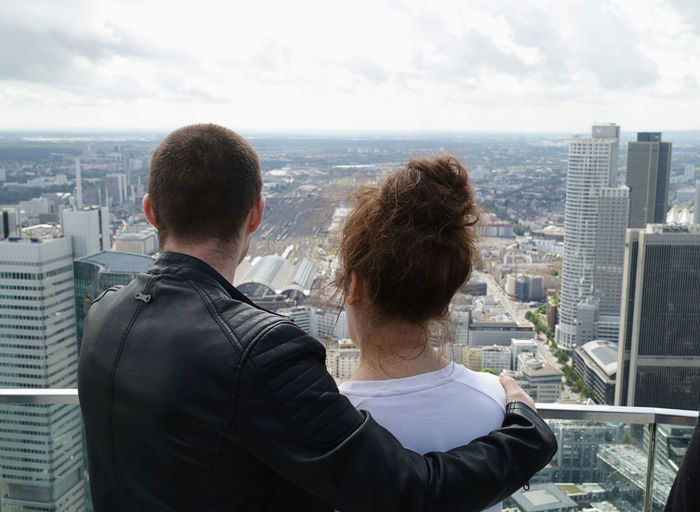 Rear View Of Couple Looking At City Against Sky
