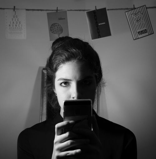 < 4 > SEA Light Lights Mexico Blackandwhite Communication Day Front View Holding Impunity Indoors  Justice Lowkey  Mobile Phone One Person Portable Information Device Real People Shadow Smart Phone Technology Wireless Technology Young Adult Young Women