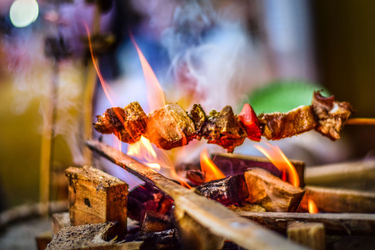 Close-up of bonfire on barbecue grill pork meat - a traditional ethnic food item