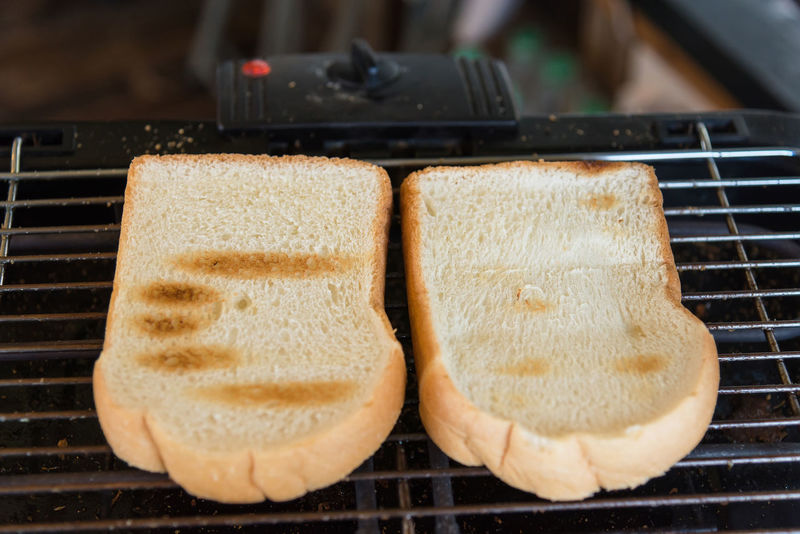 Toast on the electric stove for breakfast Bread Close-up Day Food Food And Drink Freshness Healthy Eating Heat - Temperature Indoors  No People Preparation  Ready-to-eat Toasted Bread Toaster