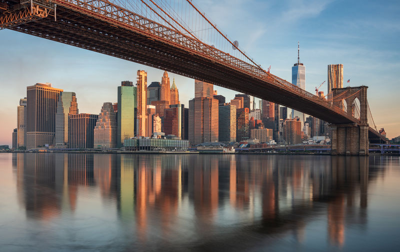 Manhattan skyline and the Brooklyn bridge Architecture Built Structure Water Sky Waterfront Building Exterior City Building Urban Skyline No People Reflection Office Building Exterior Travel Destinations Bridge River Skyscraper Outdoors Modern Cityscape Financial District  Tall - High New York Manhattan Brooklyn Bridge / New York Brooklyn Bridge  The Traveler - 2019 EyeEm Awards