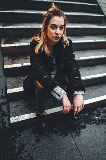One Person Staircase Young Adult Real People Hair Looking At Camera Portrait Sitting Full Length Front View Casual Clothing Young Women Lifestyles Long Hair Steps And Staircases Architecture Hairstyle Women Beautiful Woman Outdoors Leather