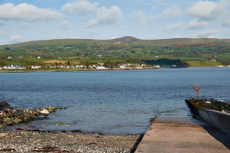 Northern Ireland East Coast. County Antrim Hills Northern Ireland Scenic Beach Blue Sky Landscape Quay Sea Water