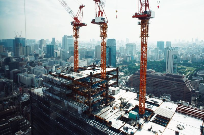 Cityscape Skyscraper City Architecture Crane - Construction Machinery Tower Development Building Exterior Urban Skyline Downtown District Built Structure City Life Business Finance And Industry Industry Harbor Modern Outdoors Day No People Travel Destinations EyeEm Selects EyeEmNewHere