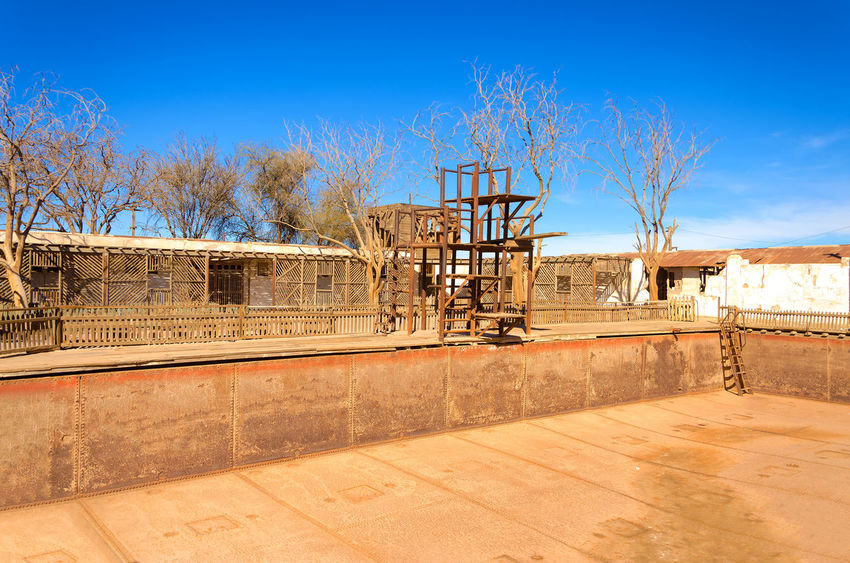 Empty swimming pool in the ghost town of Humberstone, Chile America Architecture Atacama Building Chile Derelict Desert Heritage Historic Houses Humberstone Industrial Industry Iquique Landscape Museum Nitrate Old Ruins Saltpeter Saltpetre South Town UNESCO World Heritage Site Work
