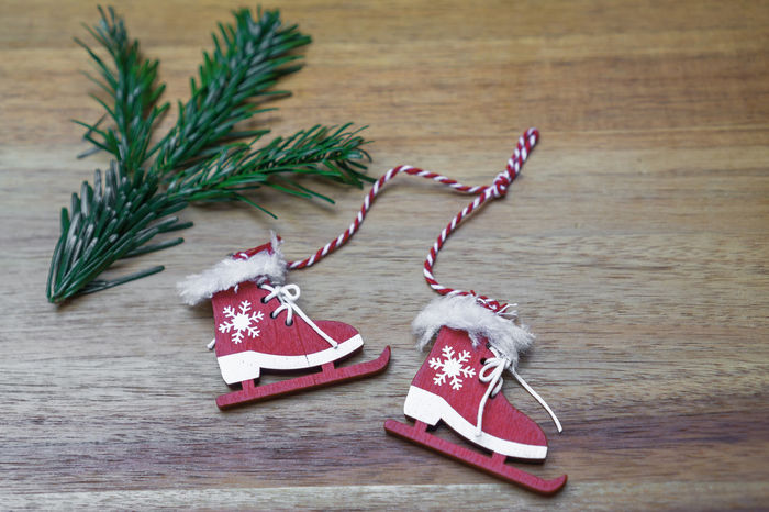 Christmas Candy Cane Celebration Christmas Christmas Decoration Christmas Decorations Christmas Ornament Christmas Ornaments Christmas Present Christmas Tree Close-up Day Holiday - Event Ice Skate Indoors  No People Ribbon - Sewing Item Skates Still Life Table Tradition Wood - Material Wooden Background