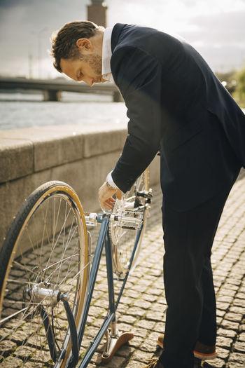 Man looking at bicycle