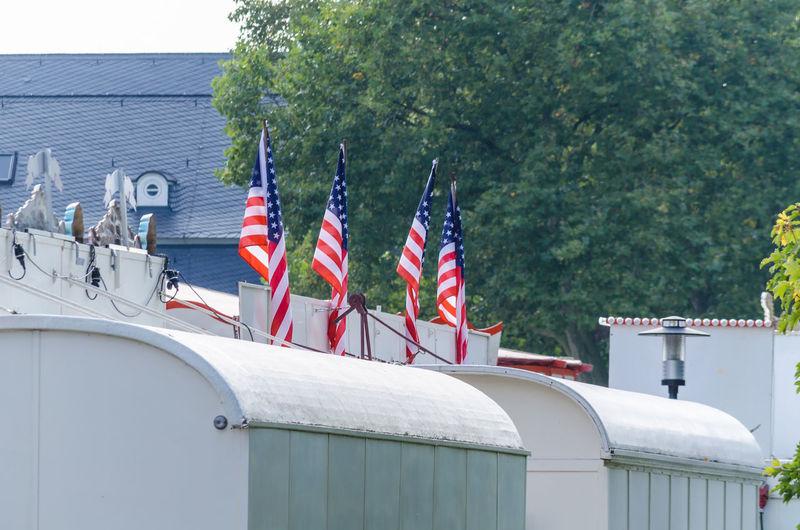 American Flags On Top Of Caravans