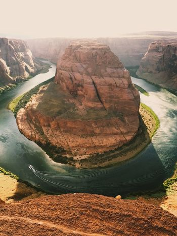 The Horseshoe Flying High Drone  Canyon Horseshoe Bend Rock - Object Nature Travel Rock Formation Travel Destinations Geology Scenics Beauty In Nature Tranquility Landscape Day Outdoors Tranquil Scene Mountain Sky No People The Great Outdoors - 2017 EyeEm Awards Neighborhood Map Live For The Story EyeEm Selects The Week On EyeEm Lost In The Landscape Perspectives On Nature Go Higher Summer Exploratorium