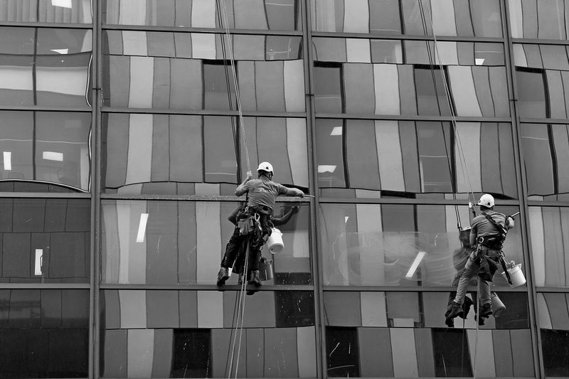 GLASGOW CITY Glasgow  Architecture Biker Building Exterior Built Structure City Cleaning Courage Danger Day Full Length Headwear Helmet Lifestyles Men Mid-air Occupation Outdoors Protective Workwear Real People RISK Skill  Stunt Person Uniform Window Washer Working