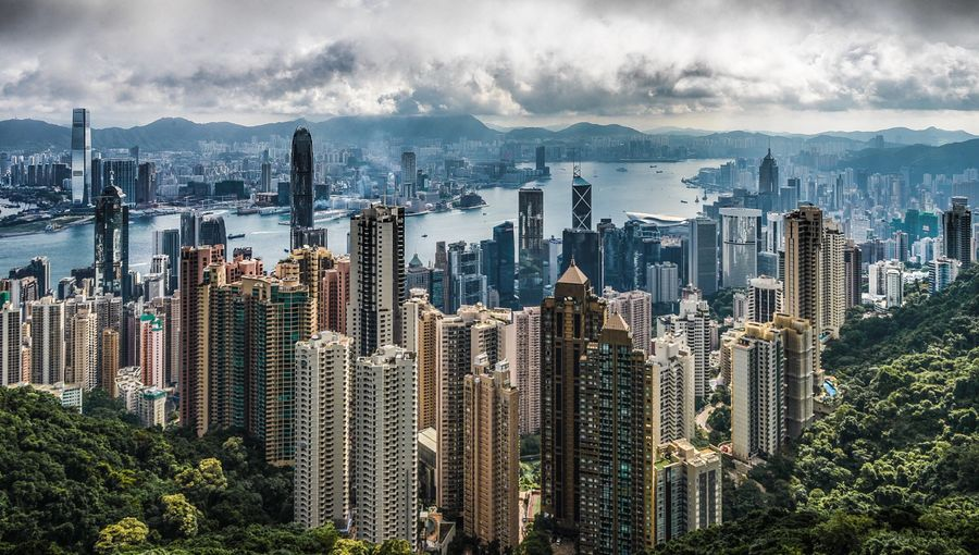 A view on a stormy day across Hong Kong, viewed from the Peak early in the morning. Such a spectacular place, much prettier than I had envisioned before I visited. HongKong Hong Kong Landscape Landscape_photography Travel Expatlife Thepeak Cityscapes