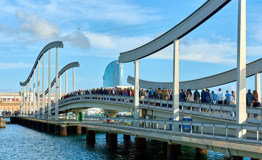 Barcelona, Spain - April 3, 2016: Rambla de Mar and Port Vell in Barcelona city. Crowd of people walking across the swing bridge on the Rambla de Mar. The Rambla del Mar is a main tourist attraction in Barcelona. Spain Architecture Barcelona, Spain Catalonia Cloudy Sky Crowd Of People Editorial  Europe Famous Place Footbridge Landmark Landscape Marine Mediterranean Sea Outdoors Pathway Pedestrian Walkway People Pier Promenade Rambla Del Mar SPAIN Sunny Day Swing Bridge Travel Destinations Walking
