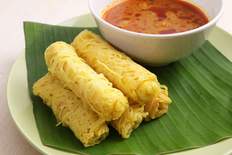 Close-up of roti jala in plate on table