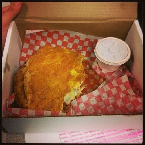This is a baby panzerotti. Paid for by the company just for working overtime. Otsaturdays Louies Ilovethisjob Halfeaten