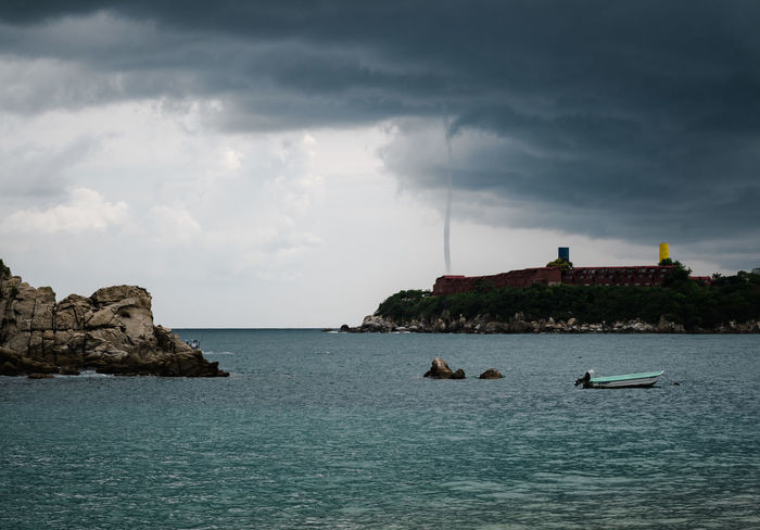 Waterspout Waterspout Beauty In Nature Cloud - Sky Day Horizon Horizon Over Water Land Nature Nautical Vessel No People Outdoors Overcast Pacific Ocean Rock Scenics - Nature Sea Sky Storm Cloud Tranquil Scene Tranquility Water Waterfront