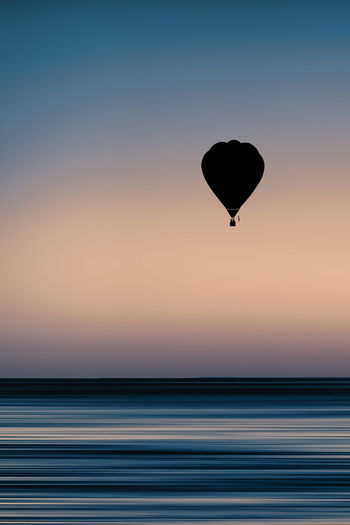Equilibrium 📷 Sunset Silhouette Flying Sky Nature Landscape Sky Clouds Sea Water No People Nature Light Mid-airSunrise Minimal Blue Colorful Horizon Outdoors Day Hot Air Balloon