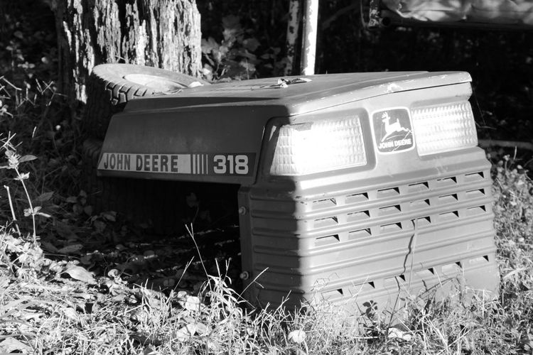 Field Land Nature Day No People Grass Selective Focus Text Outdoors Tree Trunk Communication Sunlight Tree Abandoned Container Lawnmower
