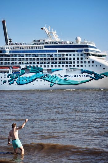 Cast Away // Hamburg // June'17 Shirtless Beach Water Vacations Sea Real People Outdoors Day Leisure Activity Travel Destinations Clear Sky Sand Building Exterior Architecture One Person Sky Swimming Nature Young Adult Adult Streetphotography Hamburg Germany Cruise Ship Candid Live For The Story