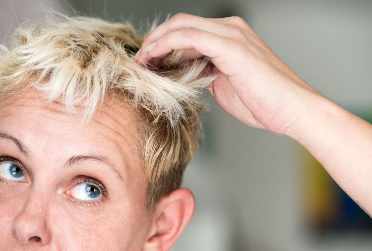 Close-Up Of Confused Blond Woman