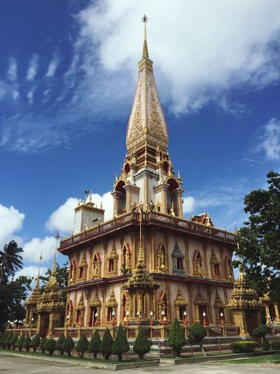 Wat Chalong Phuket Thailand Building Exterior Built Structure Architecture Sky Building Cloud - Sky Low Angle View Tower Belief Spirituality Place Of Worship Spire  Travel Destinations Religion Plant Tree Nature No People Day Outdoors