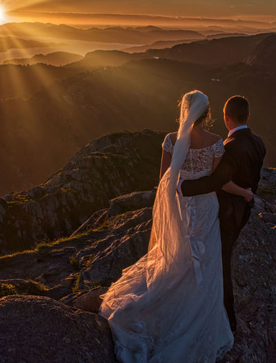 The couple Two People Real People Togetherness Love Men Women Lifestyles Bonding Couple - Relationship Leisure Activity Beauty In Nature Scenics - Nature Adult Mountain Sunset Positive Emotion Nature Non-urban Scene People Sky Outdoors Wedding Wedding Photography Landscape Loving