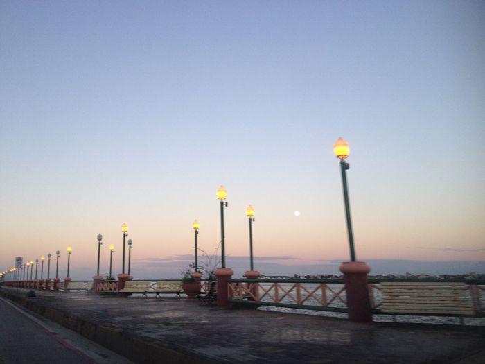 Illuminated Street Light By Sea Against Clear Sky