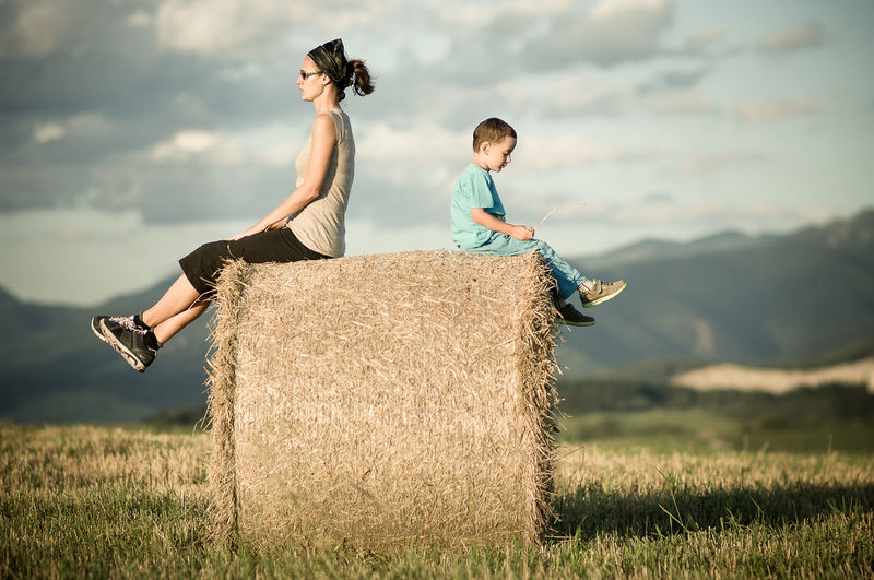 Family Meditation Son And Mother Thinking Beauty In Nature Field Joy Of Life Joy Of Moment Landscape Leisure Activity Nature Outdoors Real People Straw Bales Togetherness Young Men Young Women First Eyeem Photo EyeEmNewHere