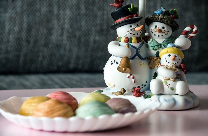 Close-Up Of Sweet Food With Figurines On Table