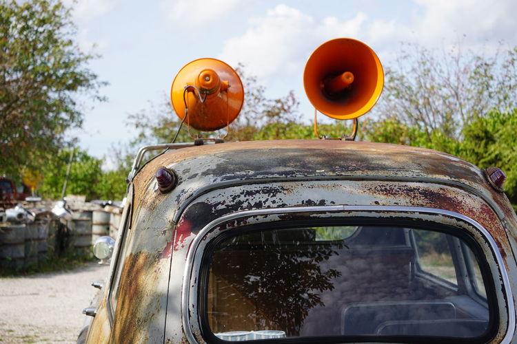 Megaphones on vintage car roof