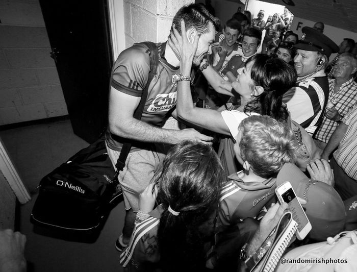 The Moment - 2014 EyeEm Awards the moment a Cork GAA hurler emerges from his dressing room and is greeted by fans celebrating his team's Munster final win Monochrome Ireland Eye4photography