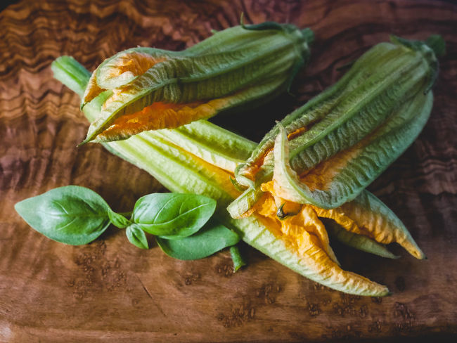 Basil Courgette Flower Close-up Directly Above Focus On Foreground Food Food And Drink Freshness Fruit Green Color Healthy Eating High Angle View Indoors  Leaf Leaves Nature No People Plant Part Still Life Table Vegetable Wellbeing Wood - Material