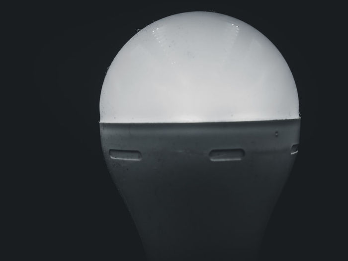 Close-up of electric light against black background