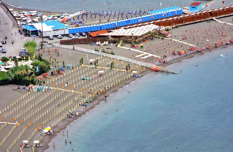 sunbeds on the beach at Sorrento, Italy Architecture Building Exterior Built Structure Day High Angle View Large Group Of People Outdoors People Real People Sorrento, Italia Sunbeds On Beach Water