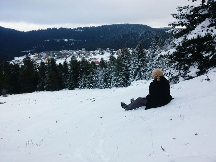 Snow Winter Cold Temperature One Person Warm Clothing Only Women One Woman Only People Outdoors Cloud - Sky Adults Only Adult Pinaceae Day Sitting Vacations Full Length Snowboarding Ski Holiday Tree Shades Of Winter