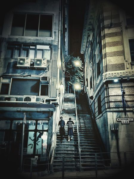 In the mood for love Couple HongKong Steep Stairs Central Hong Kong Wandering Around Aimlessly Taking Photos Taking Photos Of People IPhoneography Cyanotype Vintage Retro Styled Back In Time Quiet Night Feeling Inspired Cities At Night The Street Photographer - 2016 EyeEm Awards Last Night