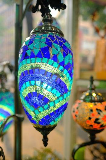 Close-up of illuminated lanterns hanging against blurred background
