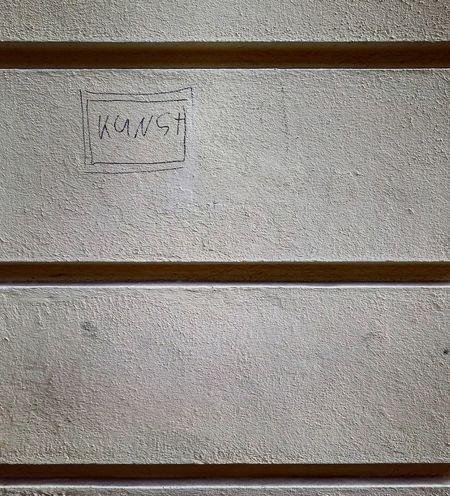 was ist das für 1 Kunst? The Street Photographer - 2017 EyeEm Awards Signs Graffiti Streetphotography Streetart Street Street Photography Berlin Art Concrete Berlin Mitte Kunst ArtWork Ist Das Kunst Oder Kann Das Weg? Wall Wallart Art Wall Lines House Wall Frame Picture Frame Text Symmetry Kunstwerk Patern