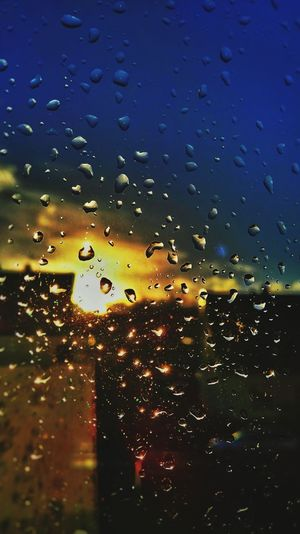 Raindrops on my windows Taking Photos Hello World Hi! Teardrops Light And Rain Colours Coloursplash What I Saw Raindrops Window Reflections Window Light ColourfullSun And Rain Reflections Shining Light