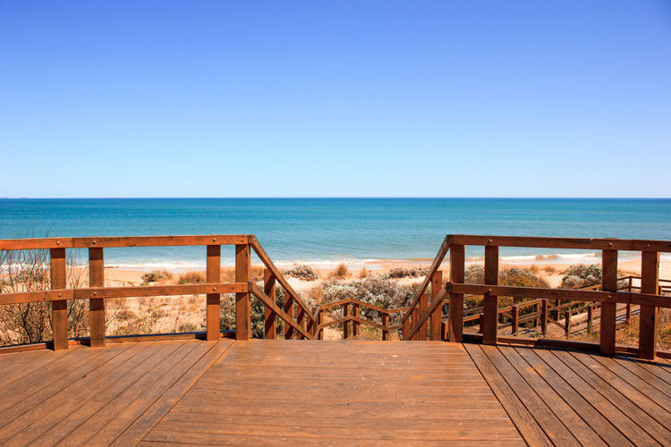 Beauty In Nature Blue Boardwalk Buffalo Beach Clear Sky Day Deck Empty Horizon Over Water Long Nature Pier Railing Scenics Sea Seascape Shore The Way Forward Tranquil Scene Tranquility Vacations Water Wood Paneling Wooden