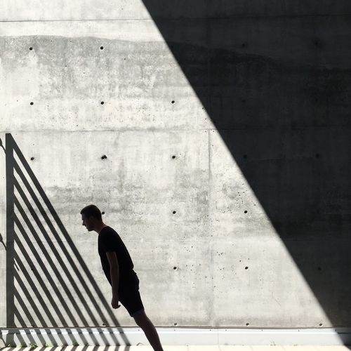 Shadow of man walking on floor