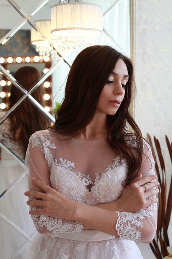 Hairstyle Bride Wedding Wedding Dress Wedding Photography Wedding Day Mirror Reflection One Person Young Adult Young Women Women Standing Beauty Looking Long Hair Beautiful Woman Adult Lifestyles Indoors  Hair Waist Up Real People Front View Contemplation