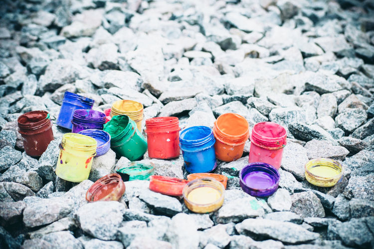 High angle view of multi colored bottles on stones