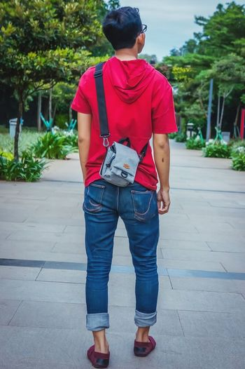straight a head Bag Sling Bag Jeans Blue Jeans Shirt Hoodie Red Shoes Canvas Shoe Standing Fashion Tree Rear View Walking Street Scene Posing Low Section Footwear Denim Rolled Up Pants Shoulder Bag