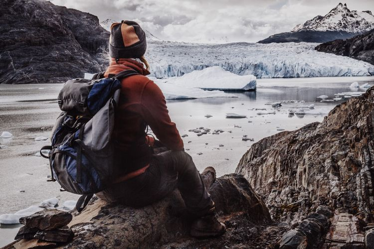 Woman Looking Glacier Grey Torres Del Paine National Park Patagonia South America Travel Photography Travel The Portraitist - 2016 EyeEm Awards One Person Alone Lake Water Ice Iceberg Adventure Outdoor The Great Outdoors - 2016 EyeEm Awards Trekking Sitting Rocks Mountains The Great Outdoors With Adobe