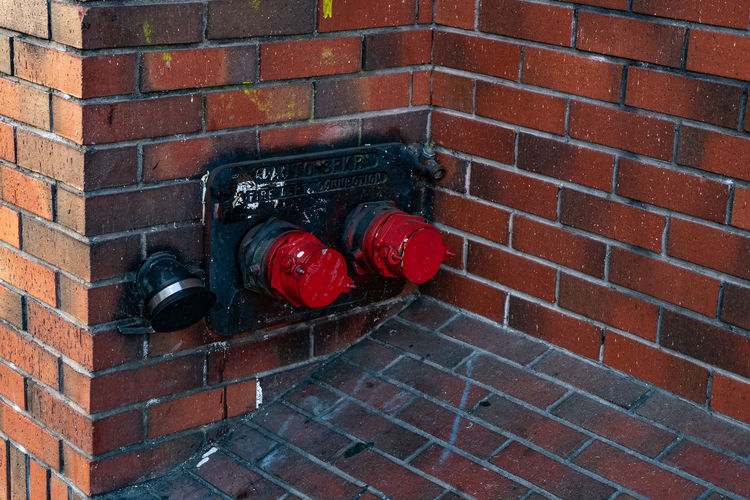 Brick Red Brick Wall Wall Wall - Building Feature Accidents And Disasters Architecture Built Structure No People Emergency Equipment Day Outdoors Pipe Technology Fire Extinguisher Fire Hydrant Connection Close-up Safety Occupation Fire Hose