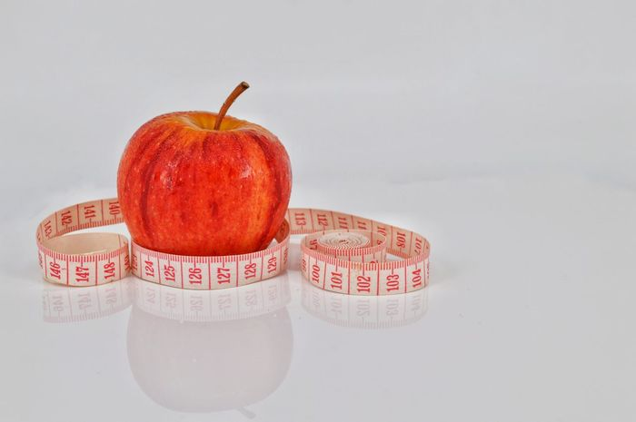 Red apple with measuring tape on white background Red No People Healthy Eating White Background Indoors  Fruit Agriculture Diet Apple Delicious Eat Food Apples Juice Freshness Object One Red Ripe Vegetarian Organic Single
