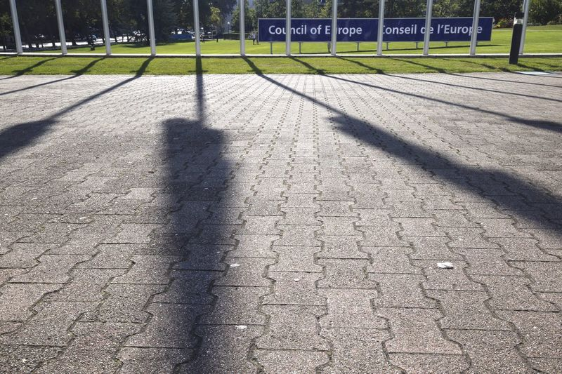 Conseil D'europe Strasbourg Modern Building Story Day Grass Shadow Sunlight Focus On Shadow Outdoors Park - Man Made Space Outline Tranquil Scene Footpath Tranquility Solitude The Way Forward European Institutions Flag Shadow