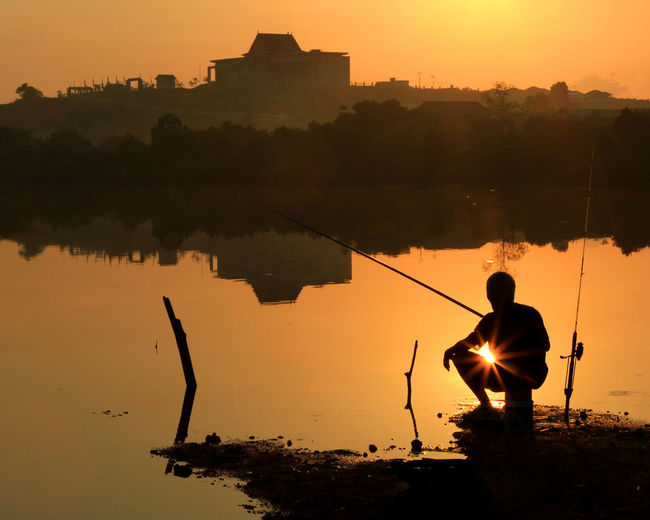 fishing Beauty In Nature Dailylife INDONESIA Kepulauanriau Ketanjungpinanglah Lake Landscapes Lifestyles Nature Orangecolor Outdoors Reflection River Scenics Senggarang Silhouette Sky Sunrise Silhouette Sunset Tanjungpinang Tranquility TravelDestinations Water Wonderfulindonesia Wonderfulkepri