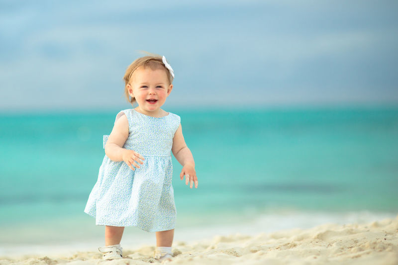 Portrait of happy girl standing on beach